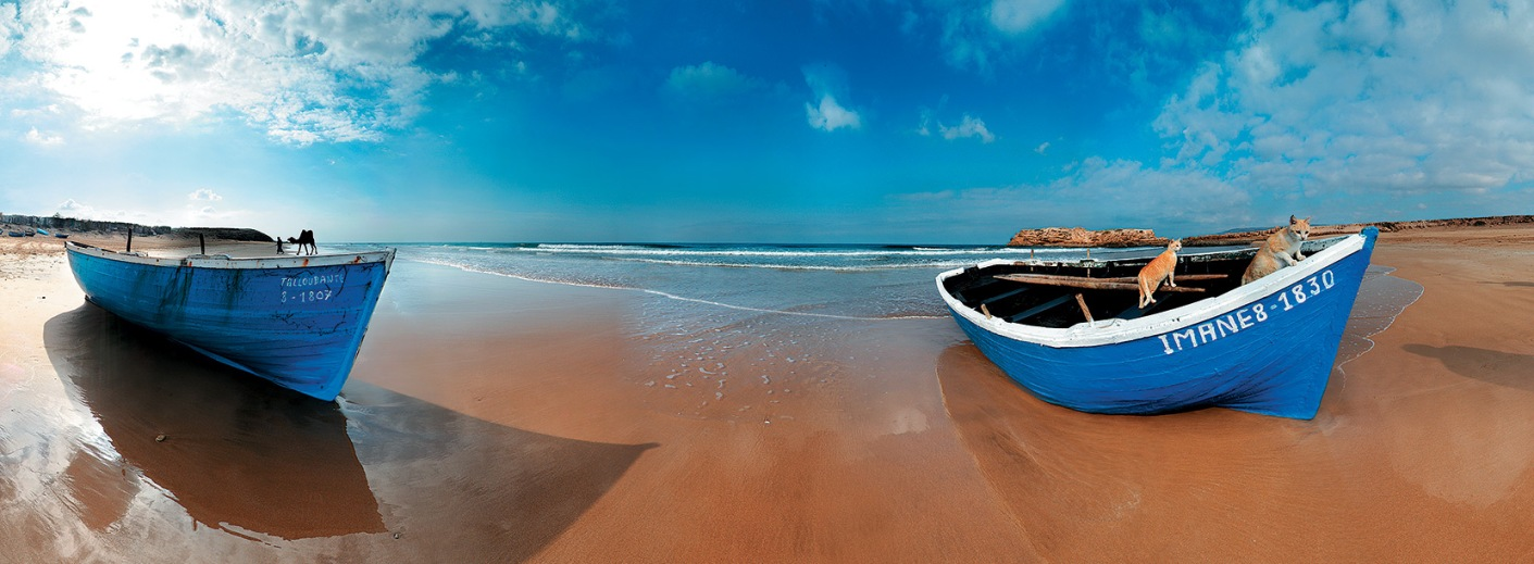 Small fishing boats on a quiet beach in southern Morocco