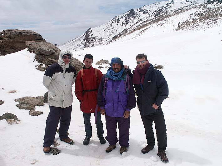 Andy (on right) with friends and guide on the col near the summit of Mount Tinergwet